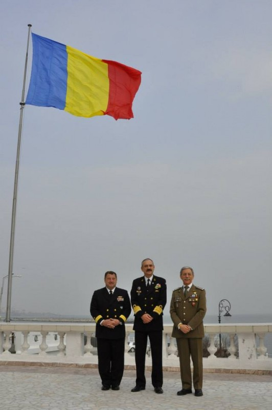 (Left to right) Standing NATO Maritime Group Two Commander, U.S. Navy Rear Admiral Brad Williamson, Rear Admiral Alexandru Marsu, Romanian Chief of Naval Forces Staff, and Allied Joint Force Command Naples Chief of Staff, Italian Army Lieutenant General Leonardo di Marco receives pose for a photo in Constanta, Romania, March 13, 2015.