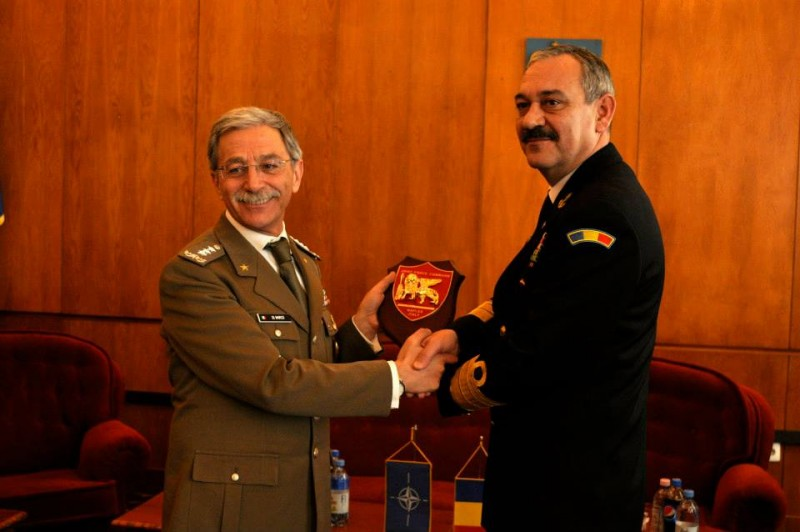 Allied Joint Force Command Naples Chief of Staff, Italian Army Lieutenant General Leonardo di Marco presents a plaque to Rear Admiral Alexandru Marsu, Romanian Chief of Naval Forces Staff in Constanta, Romania, March 13, 2015. Romania became a NATO member in 2004, and has actively participated in multiple engagements to include recent training by JFC Naples as head of the NATO Response Force.