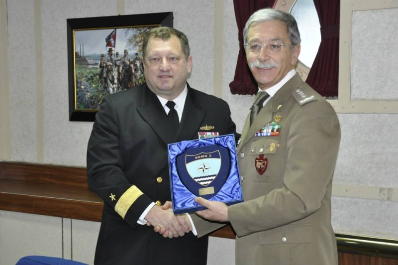 Allied Joint Force Command Naples Chief of Staff, Italian Army Lieutenant General Leonardo di Marco receives a gift from the Standing NATO Maritime Group Two Commander, U.S. Navy Rear Admiral Brad Williamson in Constanta, Romania, March 13, 2015. General di Marco and Admiral Williamson also met with the Romanian Chief of Naval Forces Staff and the Prefect of Constanta County to discuss NATO actions in the Black Sea.